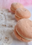 three macarons with fan and feathers